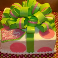 "Pink And Green Bow Cake 9"" square cake with bc frosting, gumpast bow, fondant ribbon and dots. This is my first bow and had lots of lessons learned, but am..."