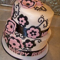 "40Th! 8"" white and 6"" strawberry cakes with buttercream frosting, fondant flowers and letters, and black slik ribbon."