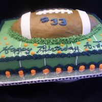 Football Cake Football cake for my nephew with his jersey number. BC w/ Fondant accents. TFL!