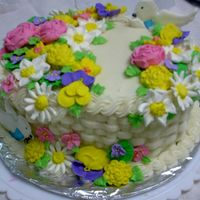 Cake11.jpg This was my final for course two. Flowers are in Royal icing. This was my first attempt at basketweaving.