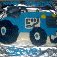 Blue Tractor This is a blue tractor decorated with bc icing.