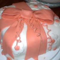Present With Bow Covered with fondant. Used Copper coloring.