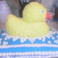 Bubble Bath Duck   Duck cake on top of a sheet cake. Covered in bc. I made this for my friends baby shower, duckies were the theme.