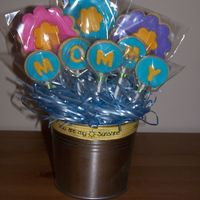 "Mommy Cookie Bouquet I nanny for a 2 1/2 yo boy, and I made this for him to give to his Mommy for Mother's Day. The ribbon says ""You are My Sunshine&..."