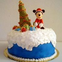 Mickey Covered panettone with fondant and RI. Fondant is airbrushed and mickey/tree is made from fondant with cmc