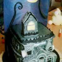 Haunted House Orange cake covered in fondant. Oh just to add the background is also edible, it's a sheet of painted sheet of pastillage.
