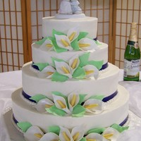 Calla Lilly Wedding Cake spice cake iced with buttercream; gumpaste calla lillies and leaves