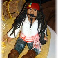 Jack Sparrow... This was part of a small collage(Jack Sparrow on the beach w/his treasure and Davy Jones's heart) that didn't fit on the cake...