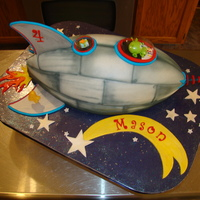 Rocket Ship This is all chocolate cake with italian meringe buttercream sculpted and covered in satin ice, then airbrushed and finished off with...