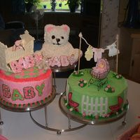 Sandy's Baby Shower Teddy is lemon sour cream poundcake accented with nfsc covered in fondant with RI trim; 9in is white almond sour cream with rapsberry cream...