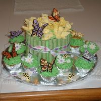 Daffodils And Butterflies Coconut cake with pineapple cheesecake filling; gumpaste daffidils and chocolate covered pirouline cookies for stems with butterflies...