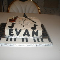 Evan's Birthday   Fondant keyboard, chocolate notes with Christmas ornaments for violin and clarinet.