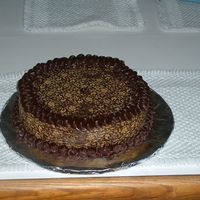 Brian's Birthday Cheesecake Chocolate cheesecake with chocolate transfers on sides and top and piped in dark chocolate ganache