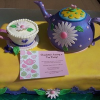 Tea Party 1/2 sheet cake, with teapot and cup. Decorations are fondant and sugar paste. Big thanks to my mom for all her help!! Thanks mom!!