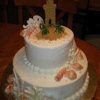 Beach Theme Fondant sand castle. All shells are chocolate, with chocolate coral. Cake is iced in BC.