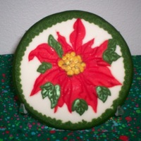 Painted Christmas Cookie This is a practice cookie. The poinsettia was impressed with a Patchwork cutter, painted with straight Americolor red, fondant center and...