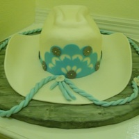 Cowgirl Hat Cake I made for this years Central Florida Fair. Front decoration and band were made out of gum paste and cut with my Silhouette.