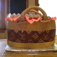 My First Purse Cake I made this for my friends birthday. it was quite a challenge but she loved it. i used chocolate ganache for the outside of the cake. The...