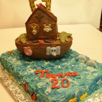 Noah's Ark Fondant animals- some freehand, some from molds. Candy clay covered 1/2 football for ark, on an 11x15 sheet cake iced in tri-color smbc fro...