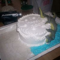 "Kraken Cake I came up with the idea for this cake when I was waching ""Pirates of the caribben 2 "" the tentacles are foil coverd in fondant..."