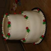 "Christmas Cake yay! my First 2 teir cake! White cake coved in MMF. 8""-6"" filled with butter cream icing. -Samantha (age 15)"