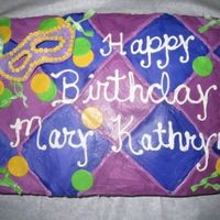 Madi Gras B-Day I matched the napkin for the party! The background is buttercream icing in a checker pattern and the mask and others are fondat/gumpaste.