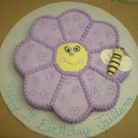 Flower And Bee 12 in cake carved into the flower. Gumpaste bumblebee. I got the inspiration from another CC member. Thanks!