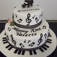 Music Note Cake This was made for my Mum's 70th birthday. Fondant covered mud cake with all of the notes, piano keys, letters & the piano on top...