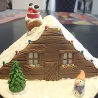Santa's Stuck Half a fruit cake covered in fondant, with sugarpaste chimney, santa, snowman etc.