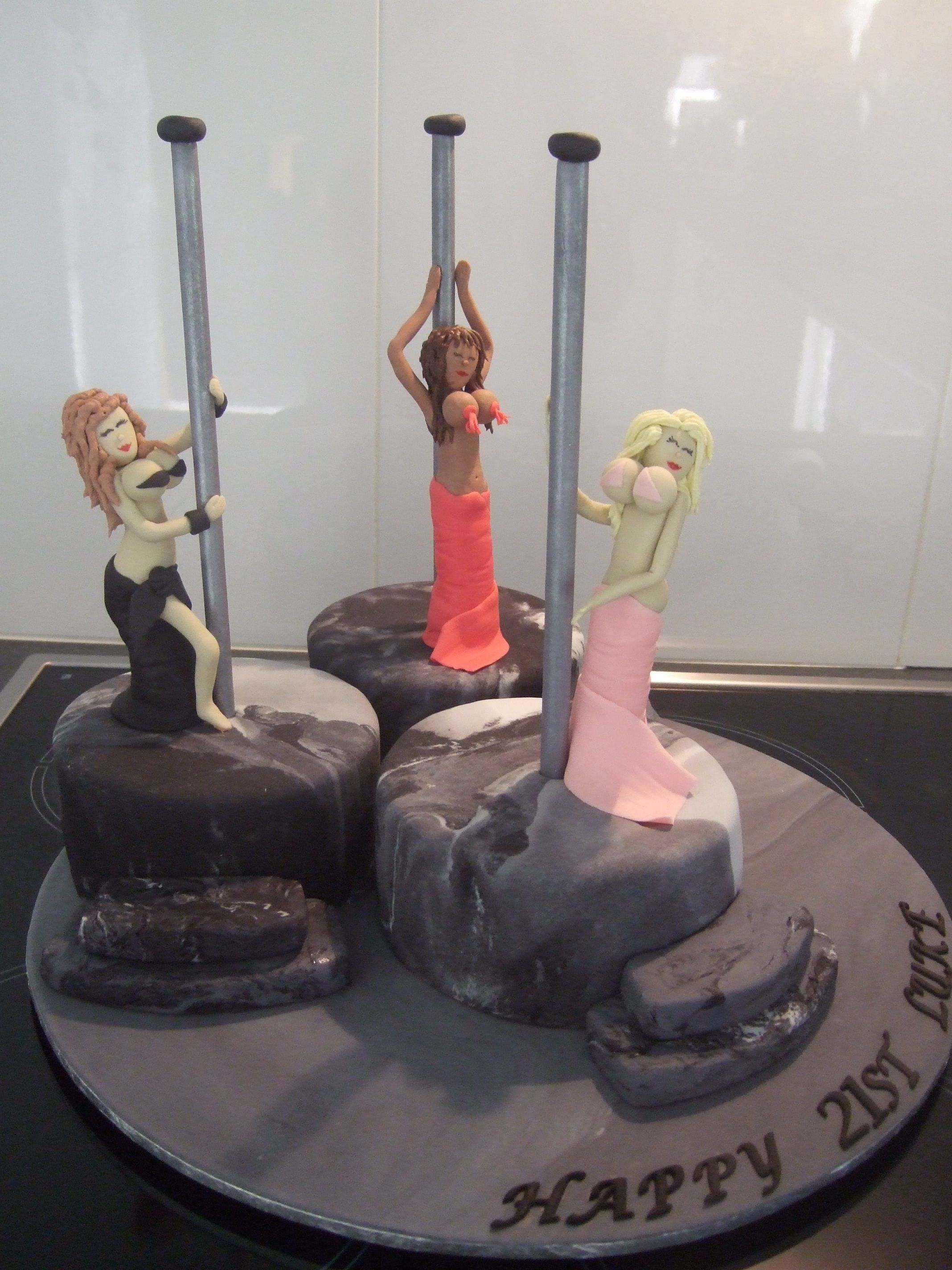 Pole Dancers Three mud cakes covered in fondant, with 3 fondant dancers. This was made for my neighbours son's 21st.