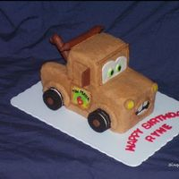 Tow Mater Birthday Cake Made this for a 6 yr old boy's birthday, who loves Tow Mater. It is covered in BC frosting with fondant accents. The wheels are Oreo...