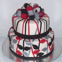 Red, Black And Silver Gift Made this for a friend's Bridal Shower. It was a trail run for her wedding cake. The bow, ribbon and accents are all made of fondant....