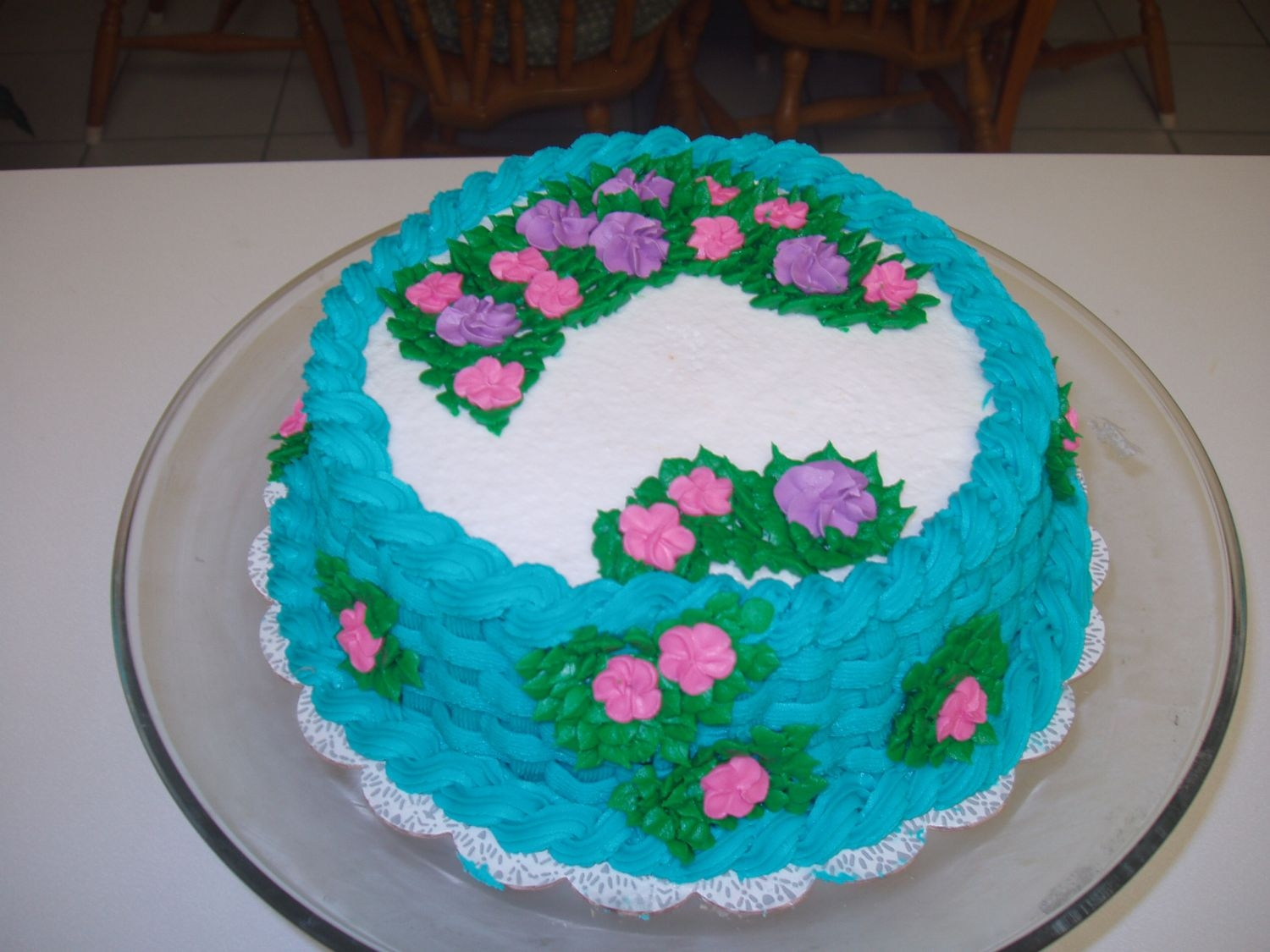 Basket Weave This was my first basket weave cake. The cake slide off the turn table that I was working on and my fingers went right into the cake in an...