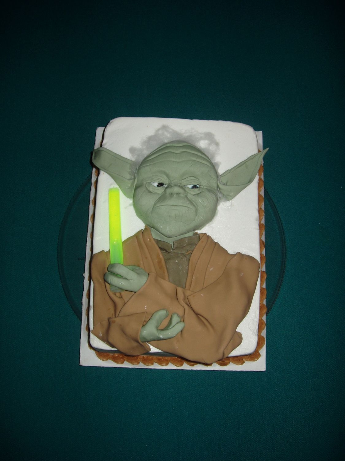 Yoda Yoda was made with fondant. He was placed on a lemon cake with buttercream icing and cream cheese filling!
