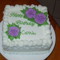 Happy Birthday Carrie Buttercream cake with royal icing flowers