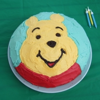 Winnie The Pooh Simple round cake decorated with buttercream icing.