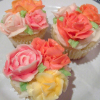"Buttercream Roses Cupcakes Buttercream roses piped using the Richard V Snyder method (I love his book, ""Sixty-Five Buttercream Flowers""). Buttercream made..."