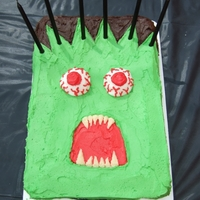 Monster Cake Simple rectangle cake with buttercream icing and giant marshmallow eyes - made for a scary monster themed party.