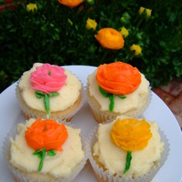 Ranunculus Cupcakes Buttercream ranunculi piped with a #104 tip.