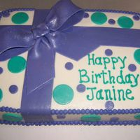 Gift Cake White cake with buttercream icing, Purple fondant bow with purple and teal fondant dots.