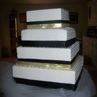 100_0846.jpg The Bride wanted a simple square cake covered in white fondant and with RI dots, The dots took forever!
