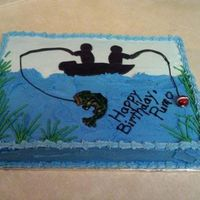 Going Fishing Chocolate cake with buttercream icing and fondant accents. Used a cake design found on this website and added a few touches.
