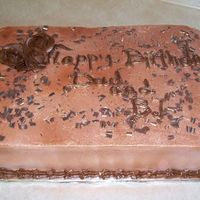 Happy Birthday Chocolate cake with buttercream sprayed with bronze luster spray and chocolate buttercream roses