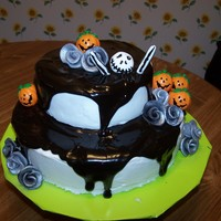 Jack Skellington And Roses White cake with chocolate ganache. Decorations are fondant, plastic pumpkins