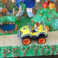 Peyton's 2Nd Birthday This was my grandson's 2nd birthday cake. His 3 teenage siblings made all the rocks on the cake. Everything was edible except Diego...