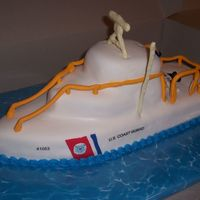 Uscg 41' Almond scented white cake with buttercream and MMF. MMF accents and edible images for USCG logo. White chocolate antenna thingies. There is...