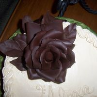 Cake From Toba Garrett's Class!! Here is yellow cake with amaretto mocha icing, topped with a hand molded chocolate plastique rose! I learned a ton in Toba Garrett's...