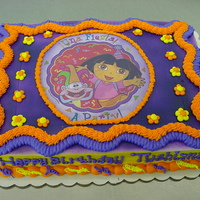 Dora Image... 1/2 Sheet Cake with a Dora Image and alot of color.