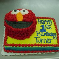Elmo 1/4 sheet cake with a double 6in for Elmo. This is how the customer asked for the cake to be done...she loved it. All BC.
