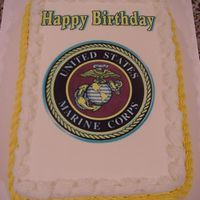 Usmc.jpg Quarter sheet cake made for a retired Marine...a little plain looking, as far as decorations go but that is all they wanted on the cake!